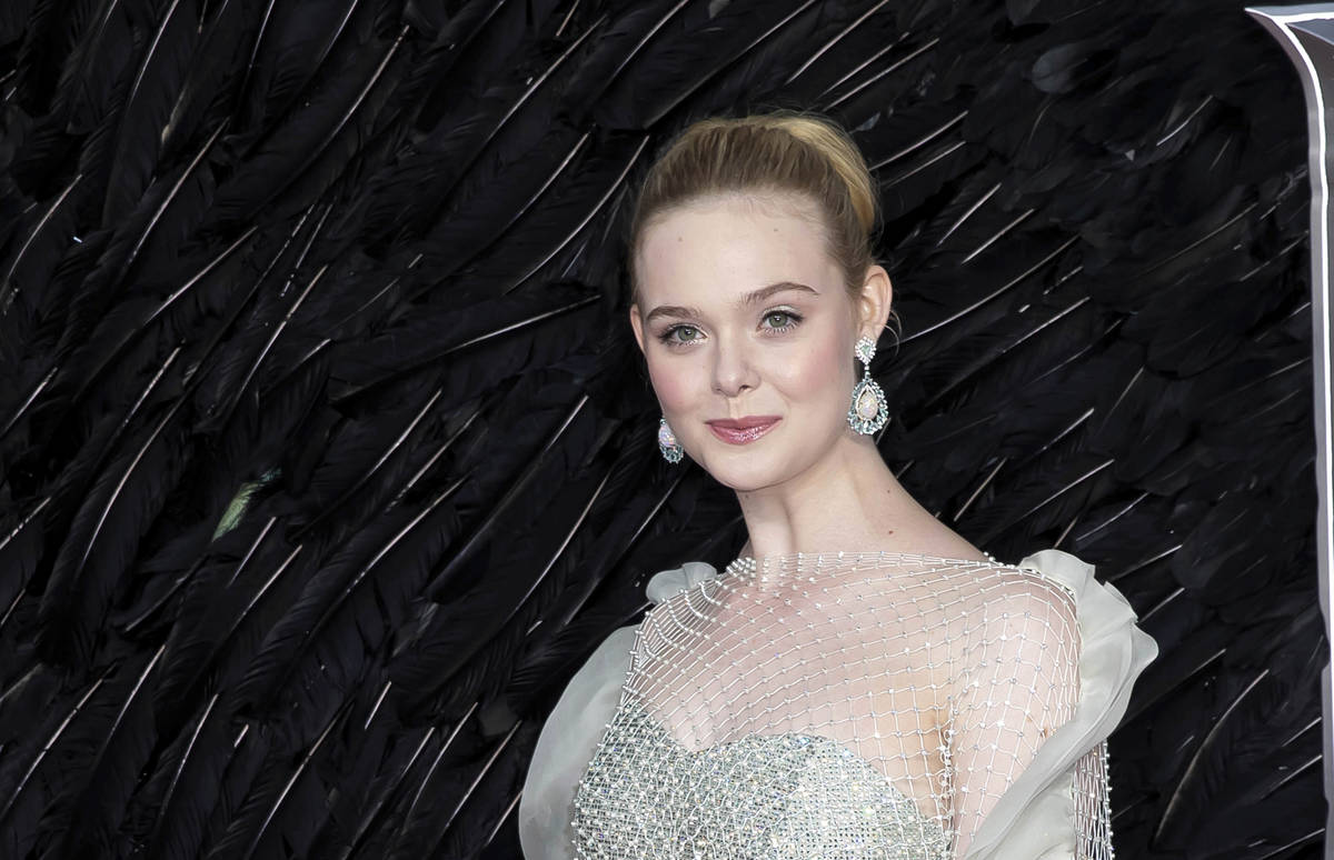 Actress Elle Fanning poses for photographers on arrival at the European Premiere of the film 'M ...