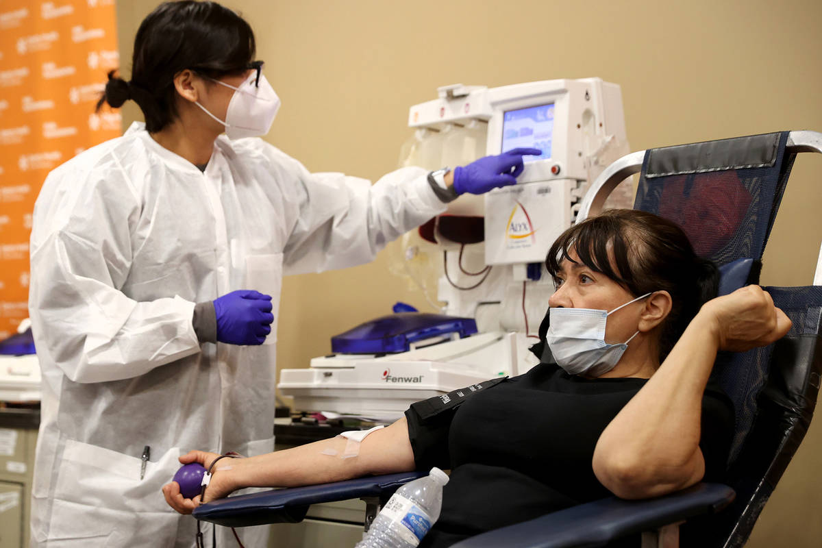 Josefina Garcia, 66, of Las Vegas donates plasma with donor care specialist Genesis Luna at St. ...