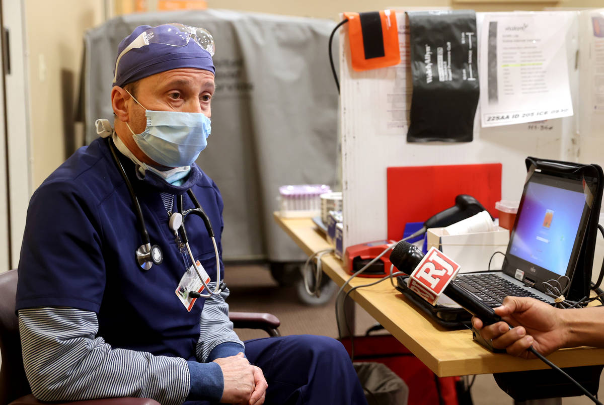 Dr. Brian Lipman talks to a reporter at St. Rose Dominican Hospital, Siena campus in Henderson ...