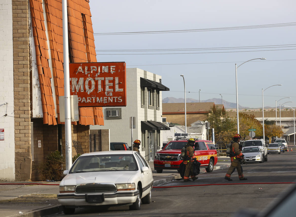 Las Vegas firefighters work the scene of a fire at a three-story apartment complex early Saturd ...