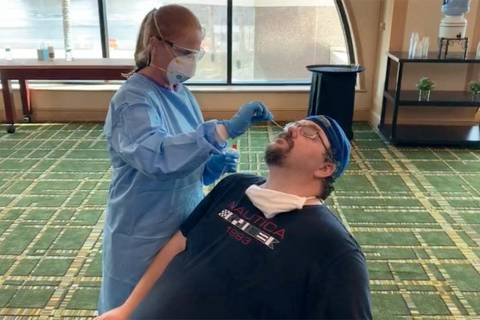 Review-Journal MMA reporter Adam Hill prepares to be tested for the coronavirus at the downtown ...
