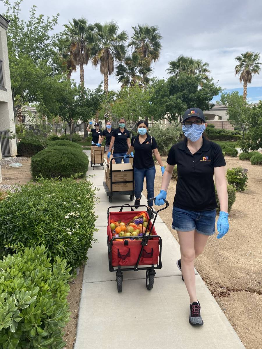 Nevada HAND team members deliver groceries to low-income seniors. (Nevada HAND)