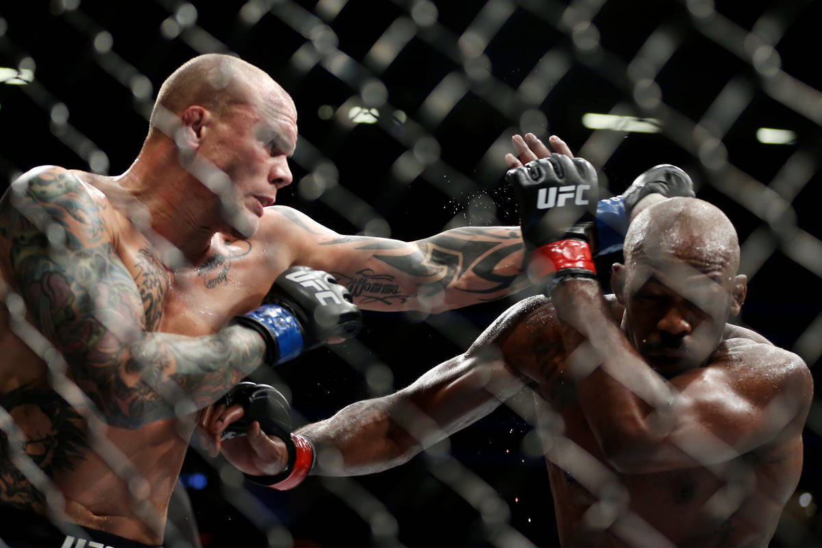 Anthony Smith, left, throws a punch against Jon Jones in the light heavyweight title bout durin ...