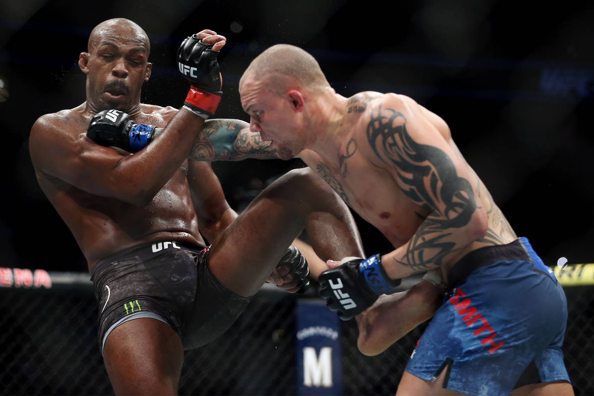 Jon Jones, left, battles Anthony Smith in the light heavyweight title bout during UFC 235 at T- ...