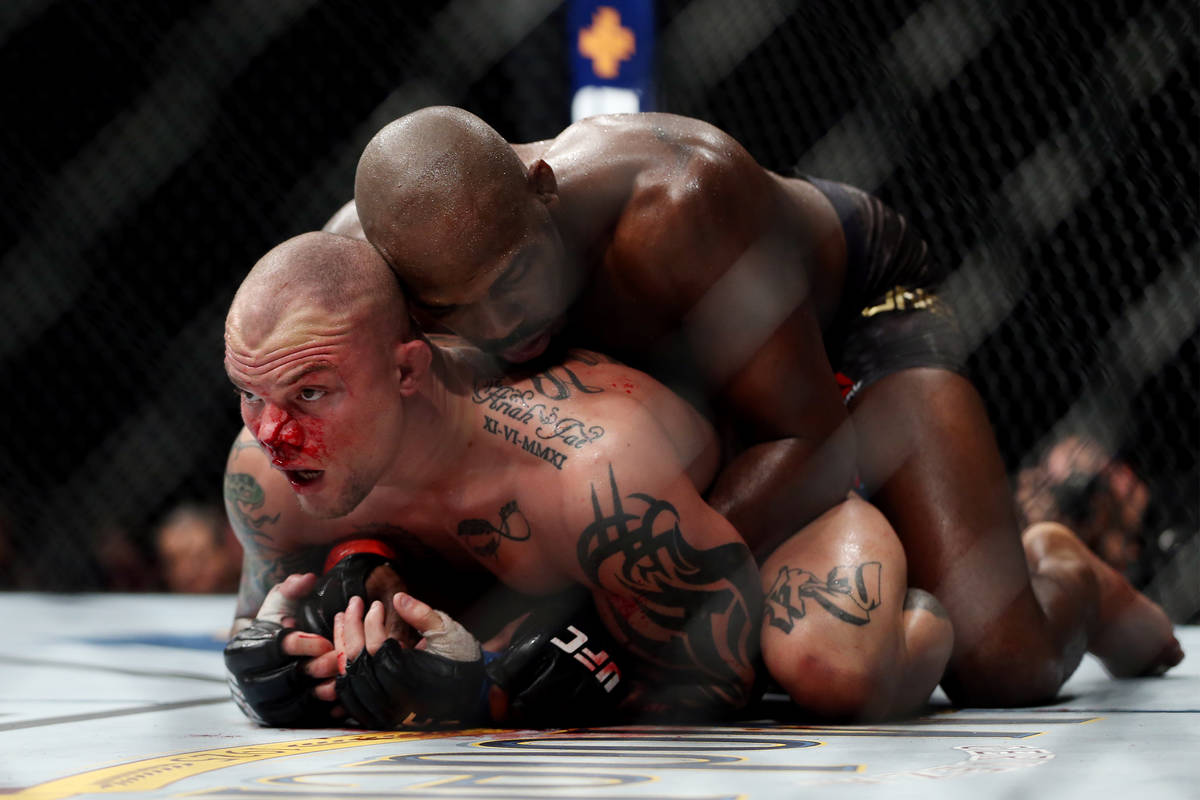 Jon Jones, top, fights Anthony Smith in the light heavyweight title bout during UFC 235 at T-Mo ...