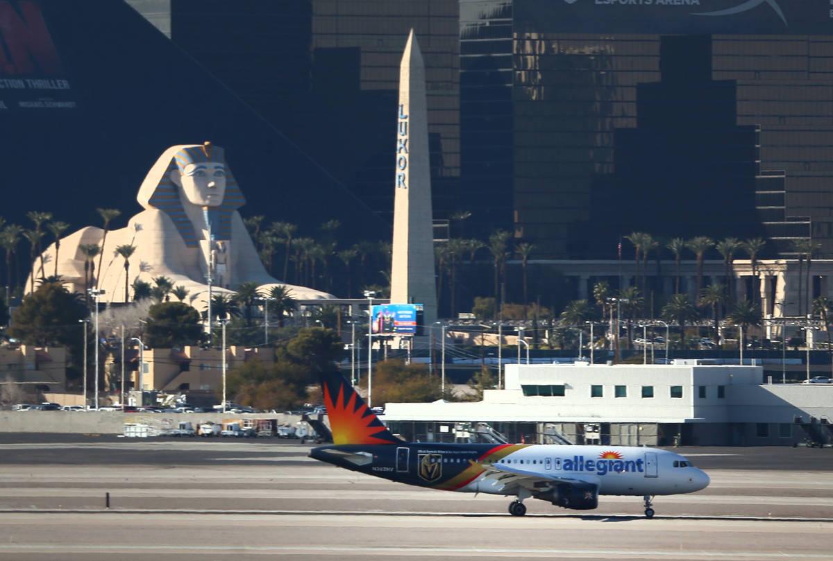 An Allegiant Air airplane taxis to a Terminal 1 gate at McCarran International Airport in Las V ...