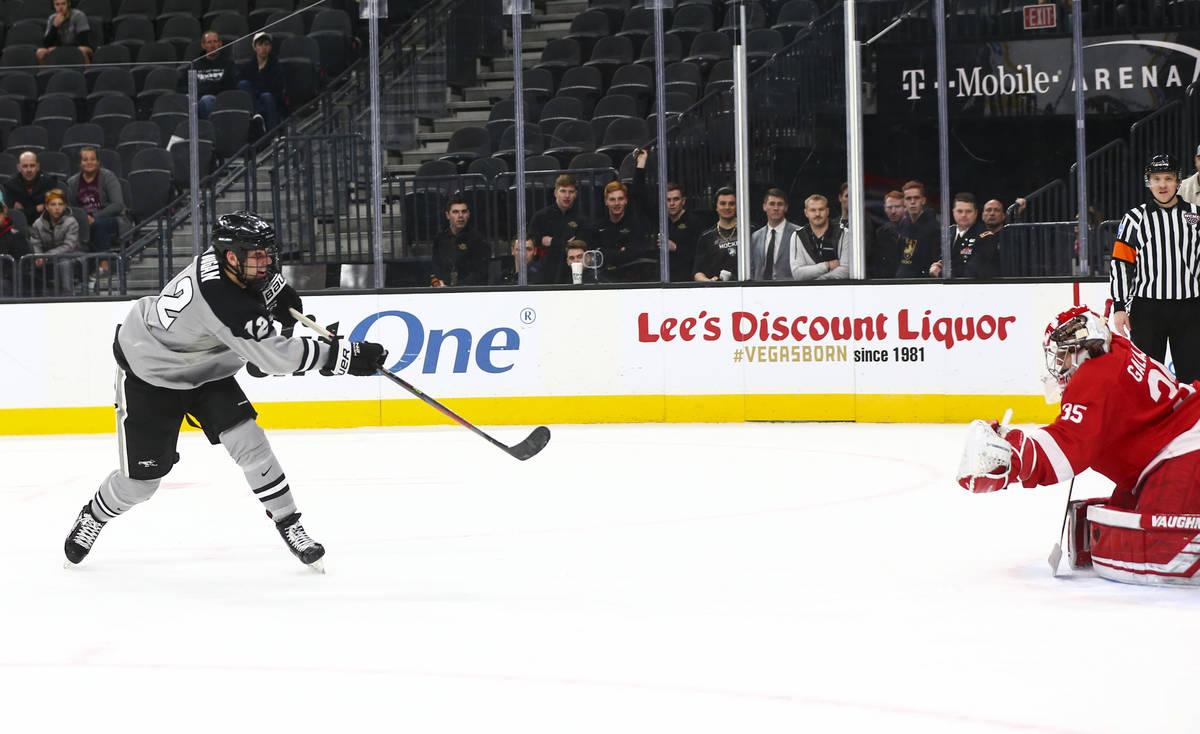 Providence Friars' Jack Dugan (12) scores past Cornell Big Red goaltender Matthew Galajda (35) ...