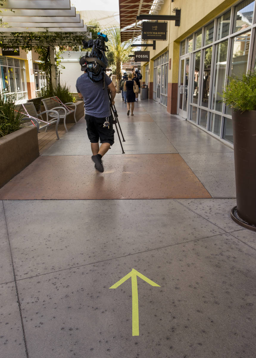 Directional walking arrows on the ground are one of the many customer information signs now ins ...