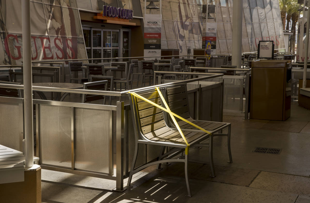 Some seating is now restricted about the food court area to encourage social distancing through ...