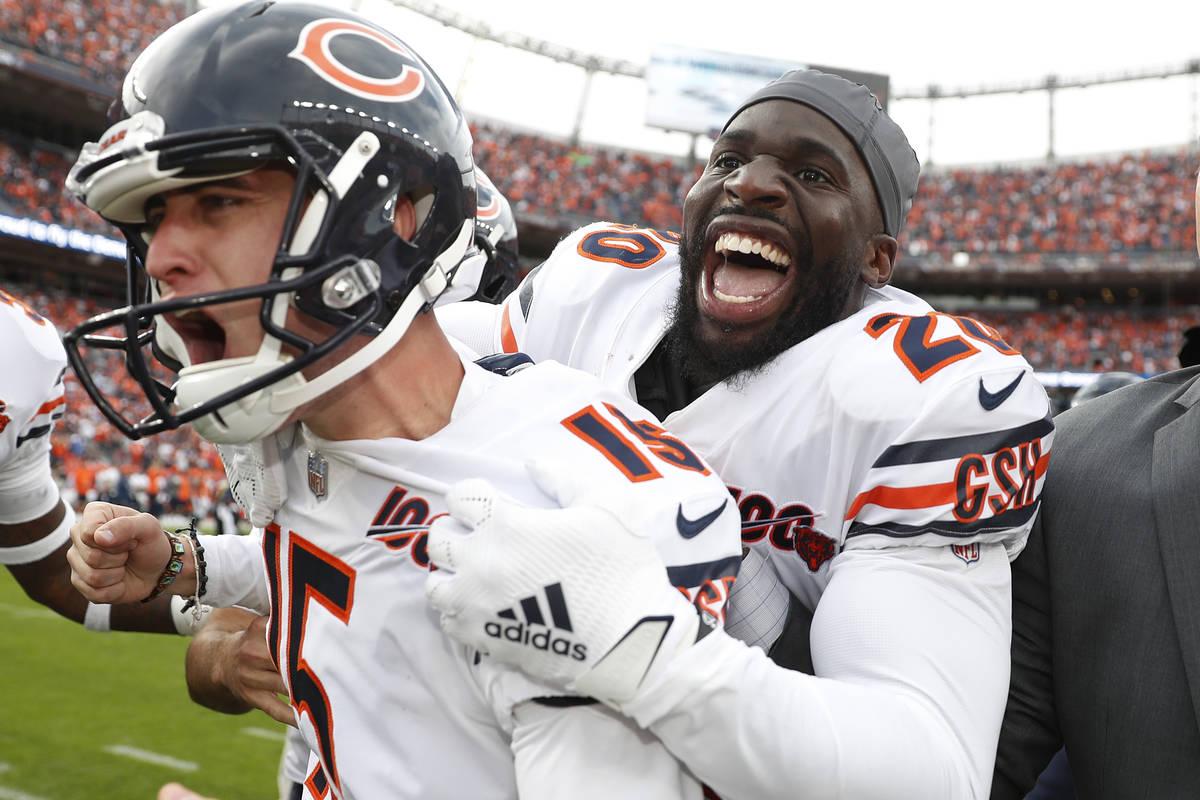 Chicago Bears kicker Eddy Pineiro, center, celebrates his game-winning field goal with free saf ...