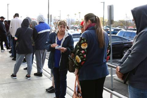 People wait in line at One-Stop Career Center on Tuesday, March 17, 2020, in Las Vegas. (Bizua ...