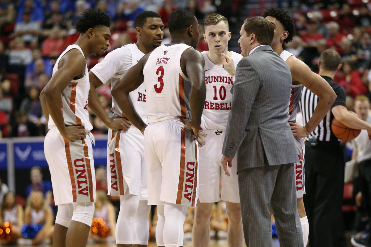 UNLV Rebels head coach T. J. Otzelberger talks to his team during a time out in the second half ...