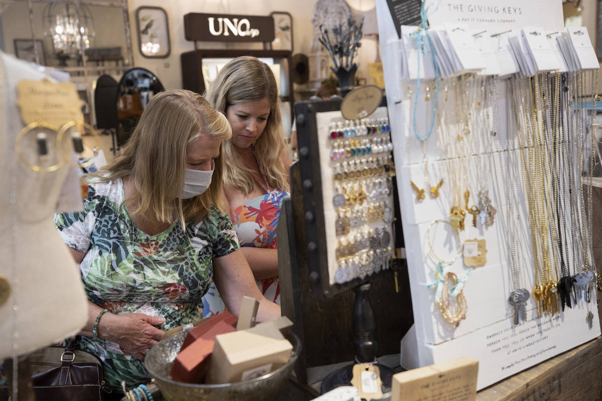 Debbie Foord, left, and her daughter Anna Corcoran shop at Magnolia Lane at The District at Gre ...