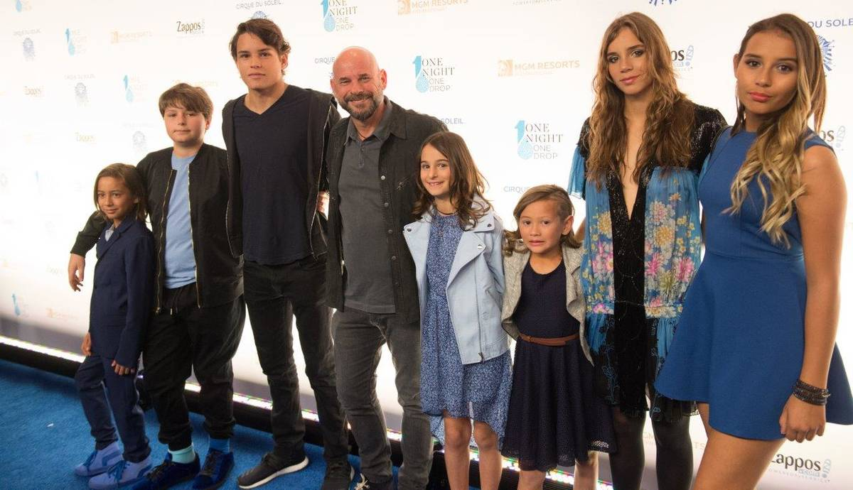 """Guy Laliberte and his family arrive on the blue carpet for the fifth-annual """"One Night for One ..."""