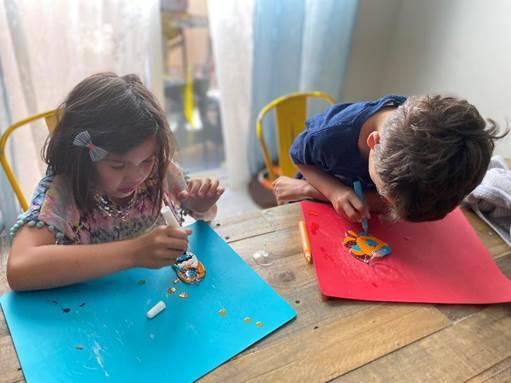 Residents of Inspirada Lily and Kaleo Mendoza enjoy creating their suncatchers. (Inspirada Comm ...