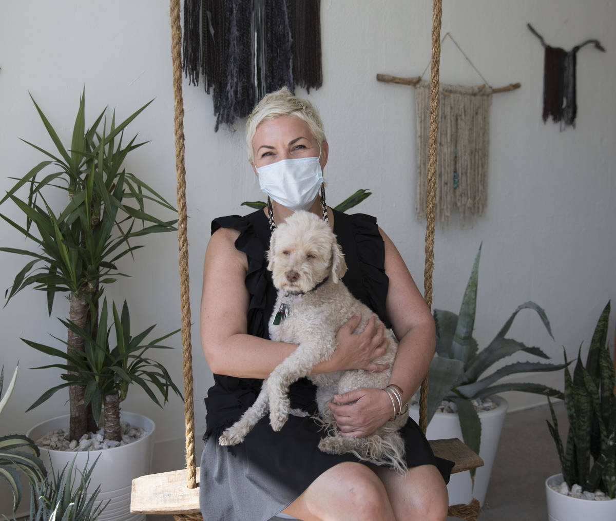 Megan Linney poses for a photo with her dog, Bowie, at her downtown Las Vegas skin care salon, ...