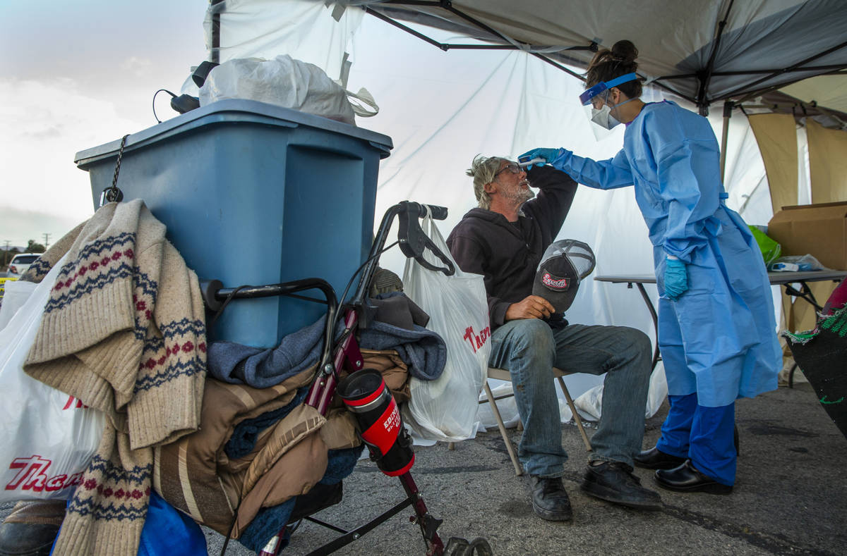 Touro University Nevada medical student Allison Moran, right, screens homeless man Gregory Hemm ...