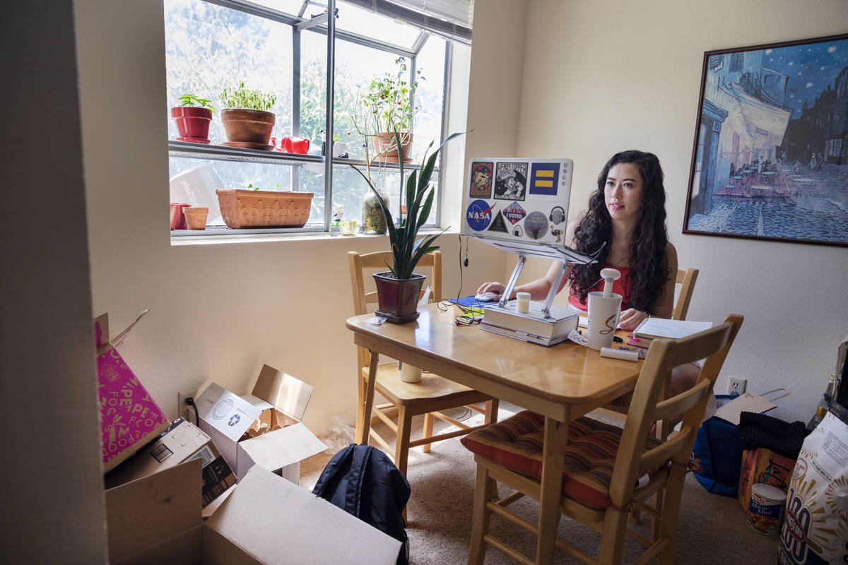 Sam O'Connell packs and cleans her apartment in Las Vegas on Tuesday, May 19, 2020. (Elizabeth ...