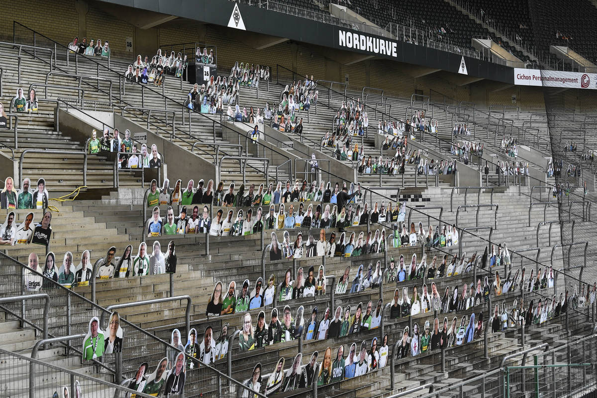 In this Thursday, April 16, 2020 file photo, portraits of fans of German Bundesliga soccer club ...