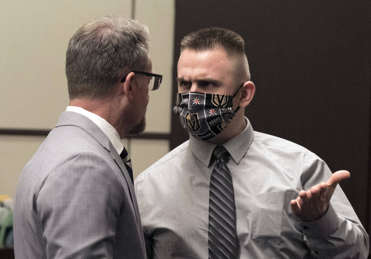 Joshua Nichols, right, accused of kidnapping, burglary and armed robbery, confers with his lawy ...