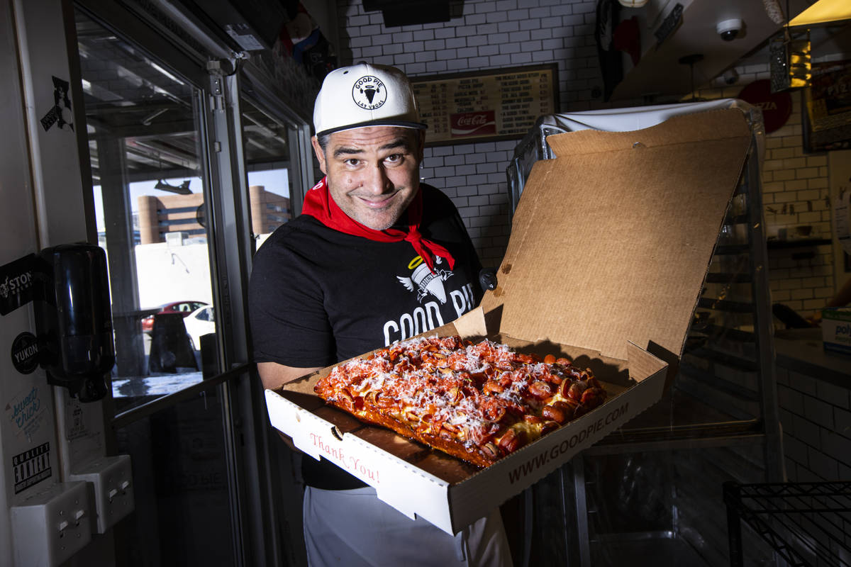 Vincent Rotolo, owner of Good Pie, poses with a triple pepperoni Detroit style pizza in downtow ...