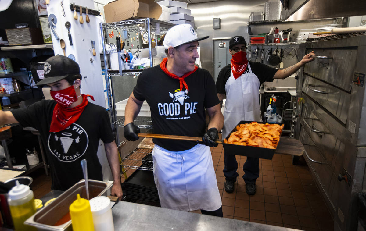Vincent Rotolo, owner of Good Pie, prepares a triple pepperoni Detroit style pizza in downtown ...