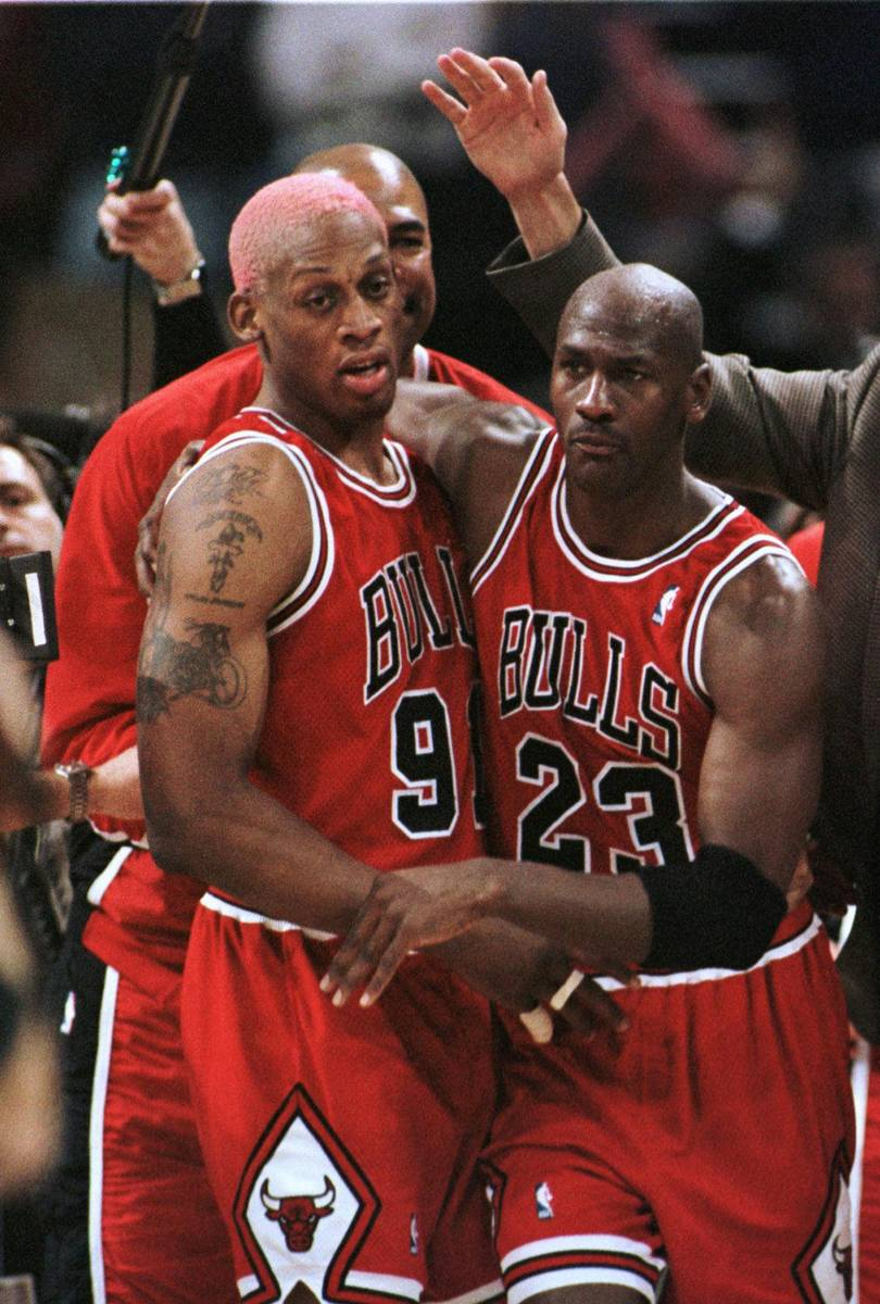 Chicago Bulls' Dennis Rodman, left, and Michael Jordan head off the court after beating the Mil ...