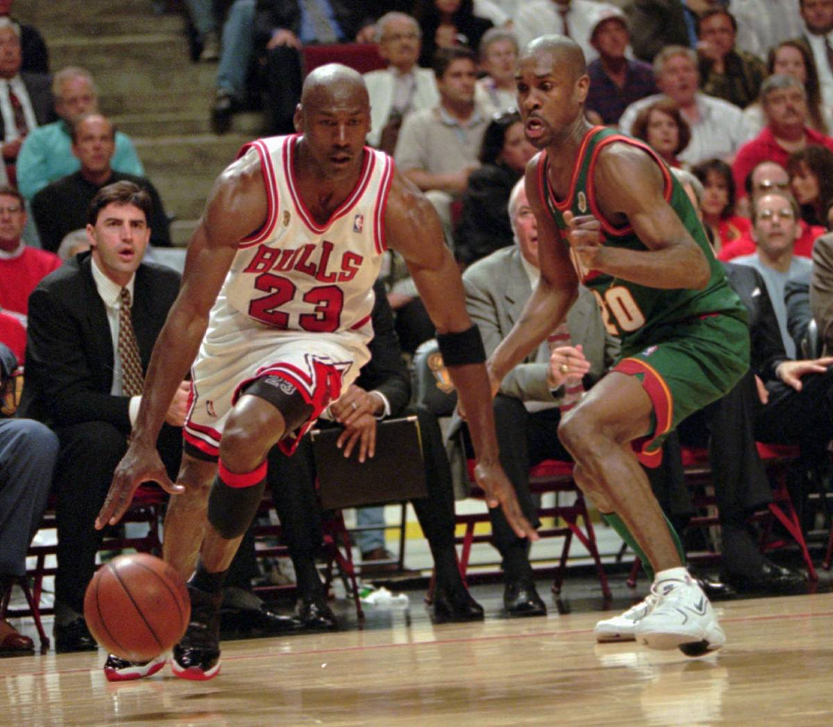 Chicago Bulls' Michael Jordan drives around Seattle SuperSonics' Gary Payton during Game 1 of t ...