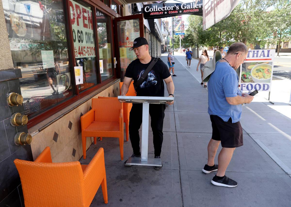 Krairit Krairavee, owner of Siam Square on East Fremont Street in downtown Las Vegas, moves tab ...