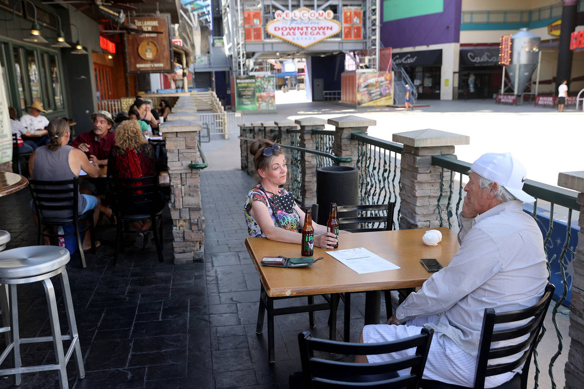 Sara Crane and James Hall, both of Henderson, dine outside at Hennessey's Tavern at the Fremont ...