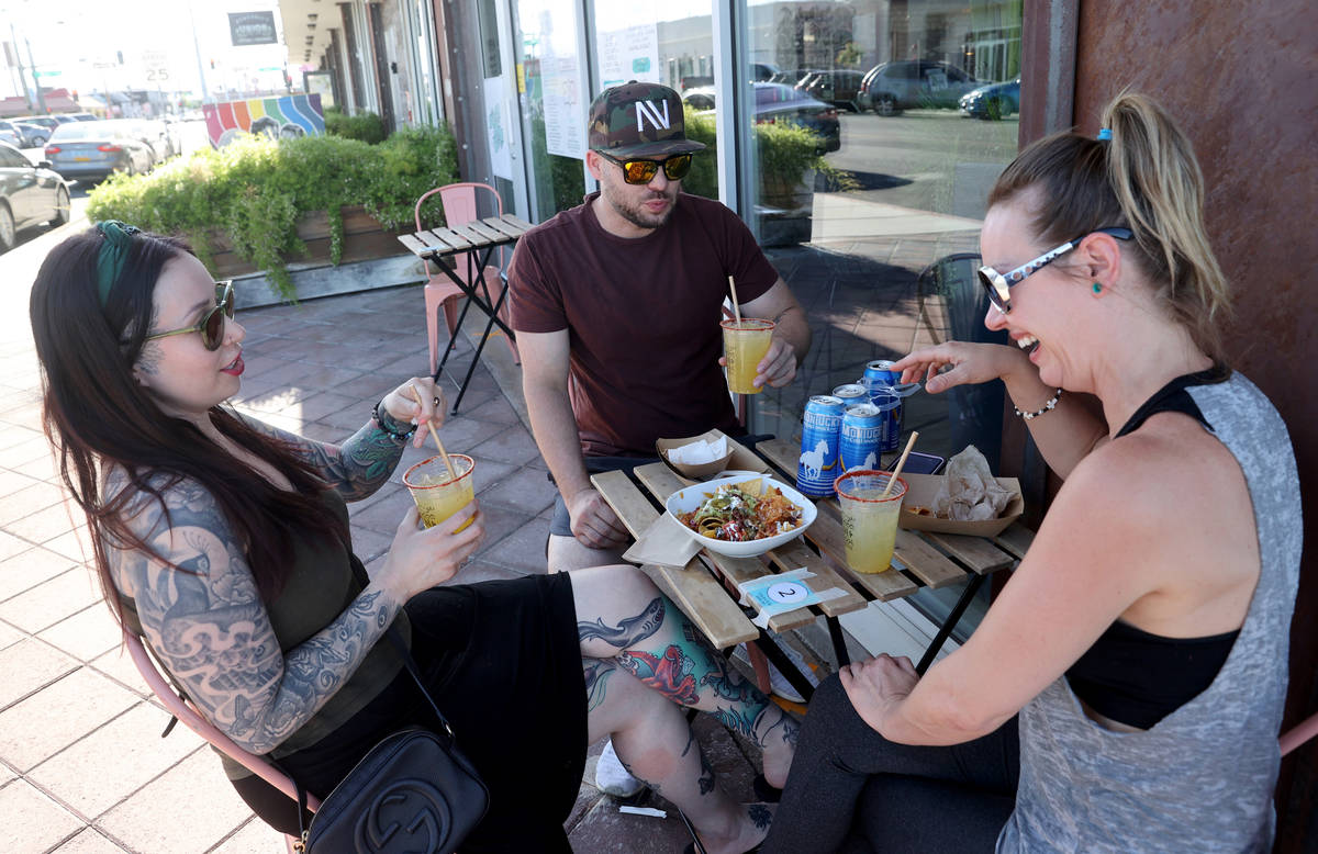 Katie Royball, from left, Sean Adams, of Las Vegas, and Tawny Shoemaker of Henders at Tacotaria ...