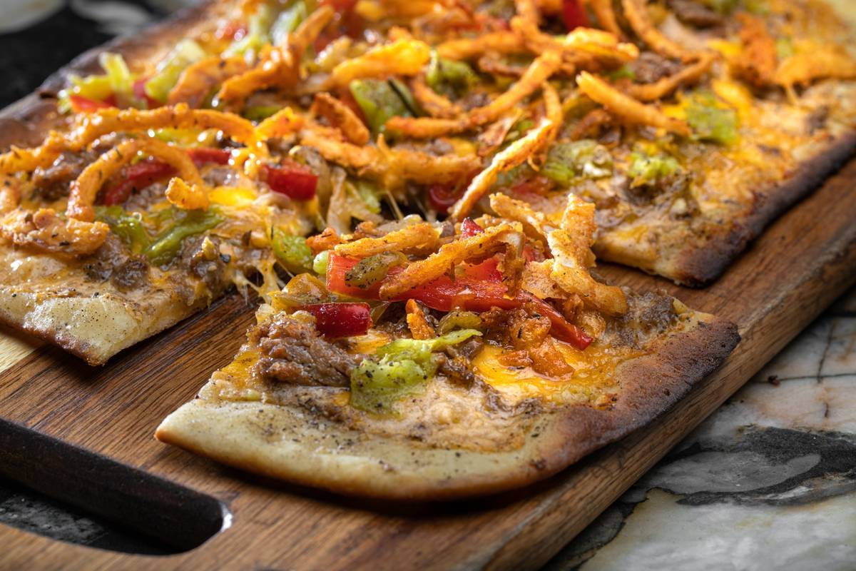 Hatch chile Philly flatbread at Carson Kitchen. The downtown eatery will reopen Thursday, May 2 ...