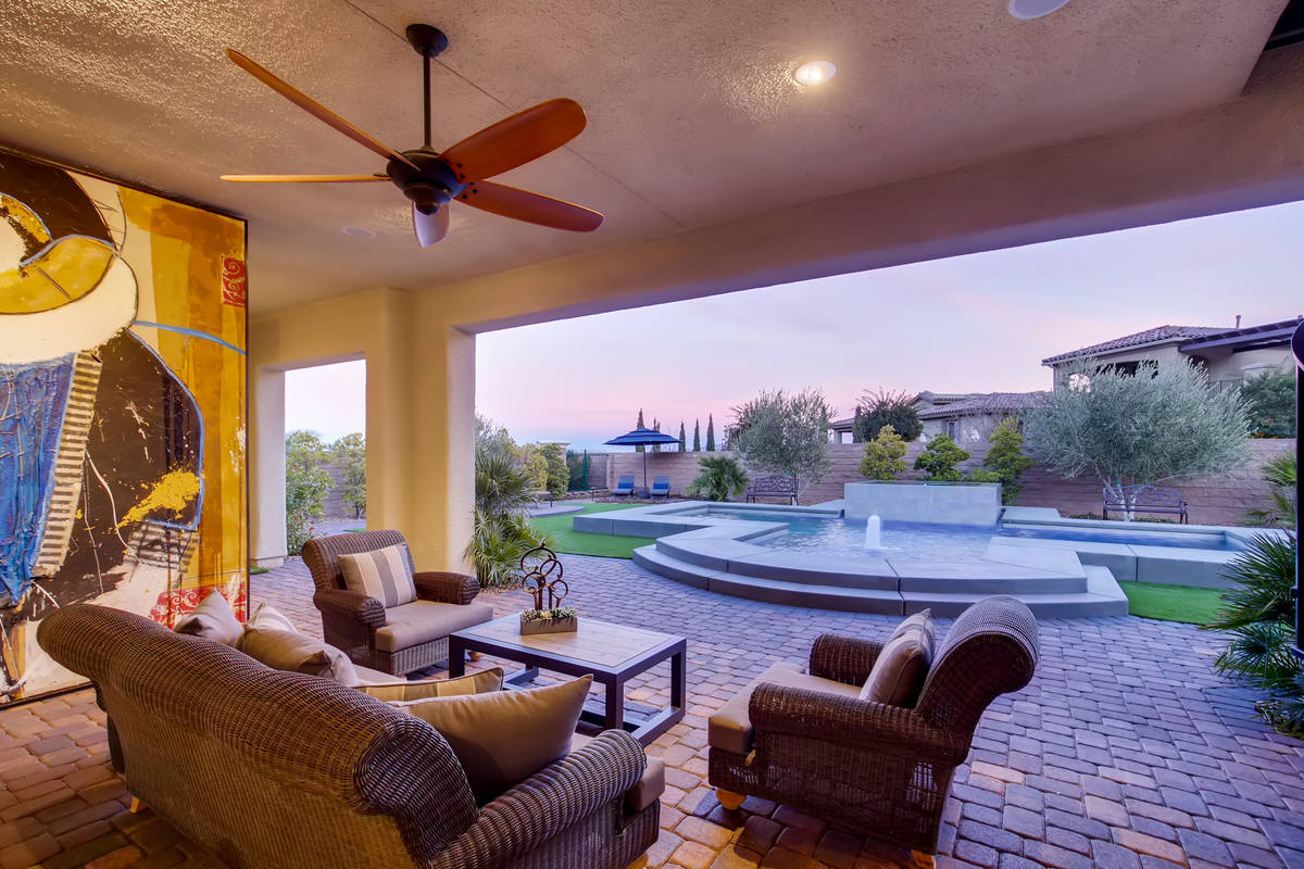 The patio leads to the pool. (Realty One Group)