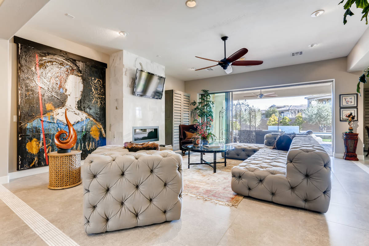 The living room features lots of art space. (Realty One Group)