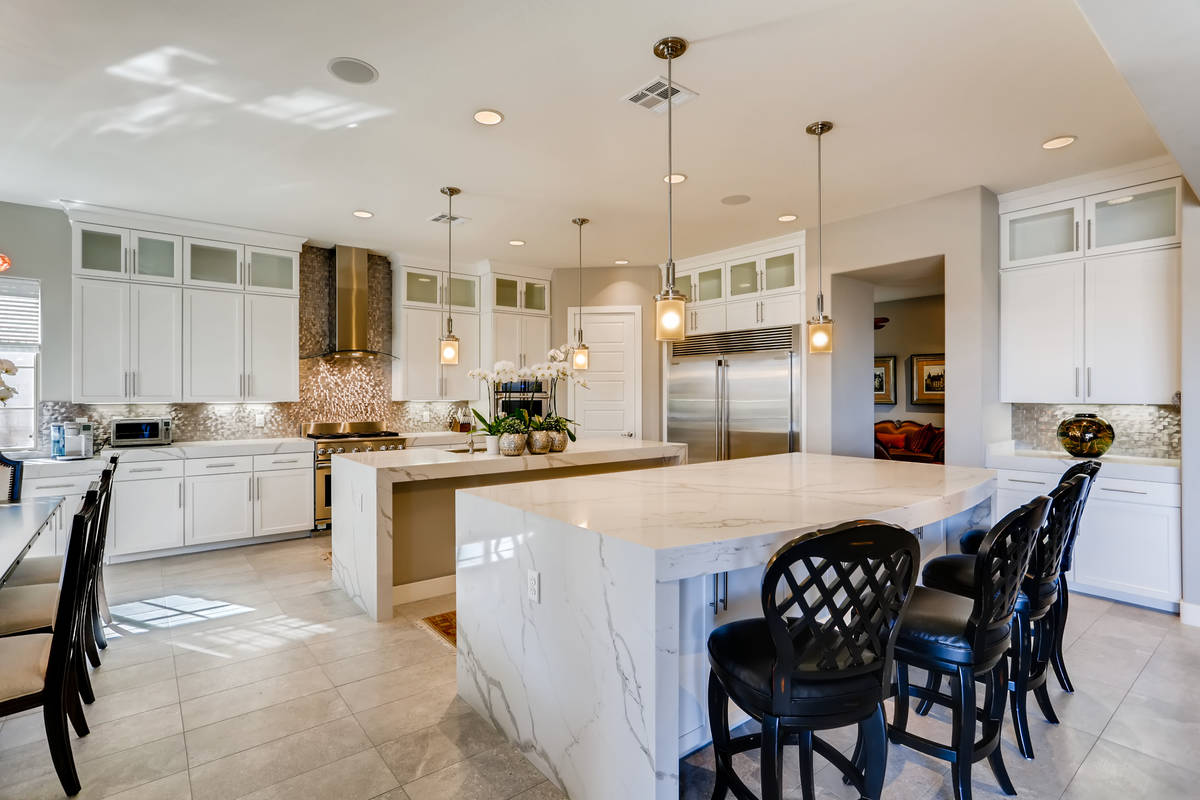 The kitchen has two large islands. (Realty One Group)