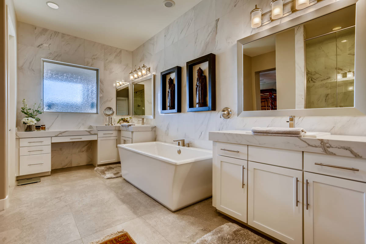 The home includes a large master bath adjacent to the master suite. It has a large soaking tub. ...