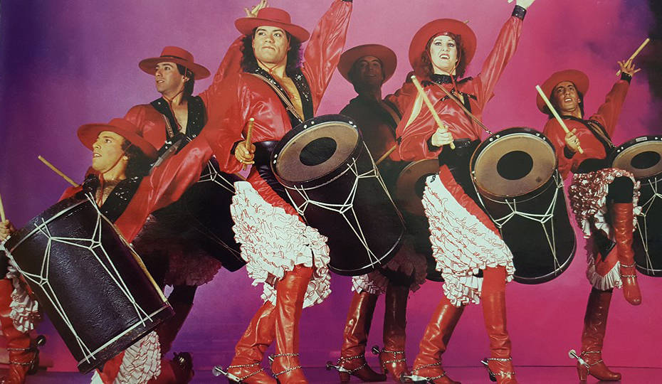 Luis A. Frias, third from left, leads the Los Gauchos Latinos dance troupe, performing with the ...