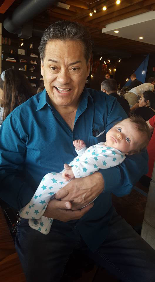 Luis A. Frias holds one of his six grandchildren. (Luisa Frias)