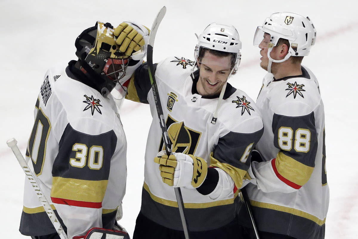 Vegas Golden Knights goalie Malcolm Subban, left, celebrates with defensemen Colin Miller, cent ...