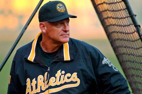 FILE - In this Sept. 30, 2002, file photo, Oakland Athletics manager Art Howe watches over warm ...