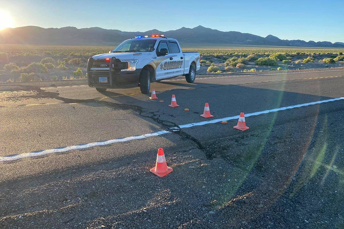 A Esmeralda County Sheriff's Office vehicle and cones block U.S. Highway 95 near Coaldale in we ...