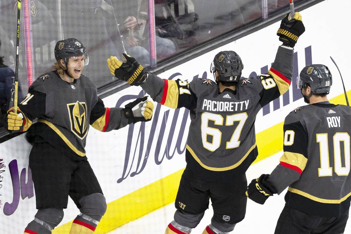 Vegas Golden Knights center William Karlsson (71) celebrates with Vegas Golden Knights left win ...