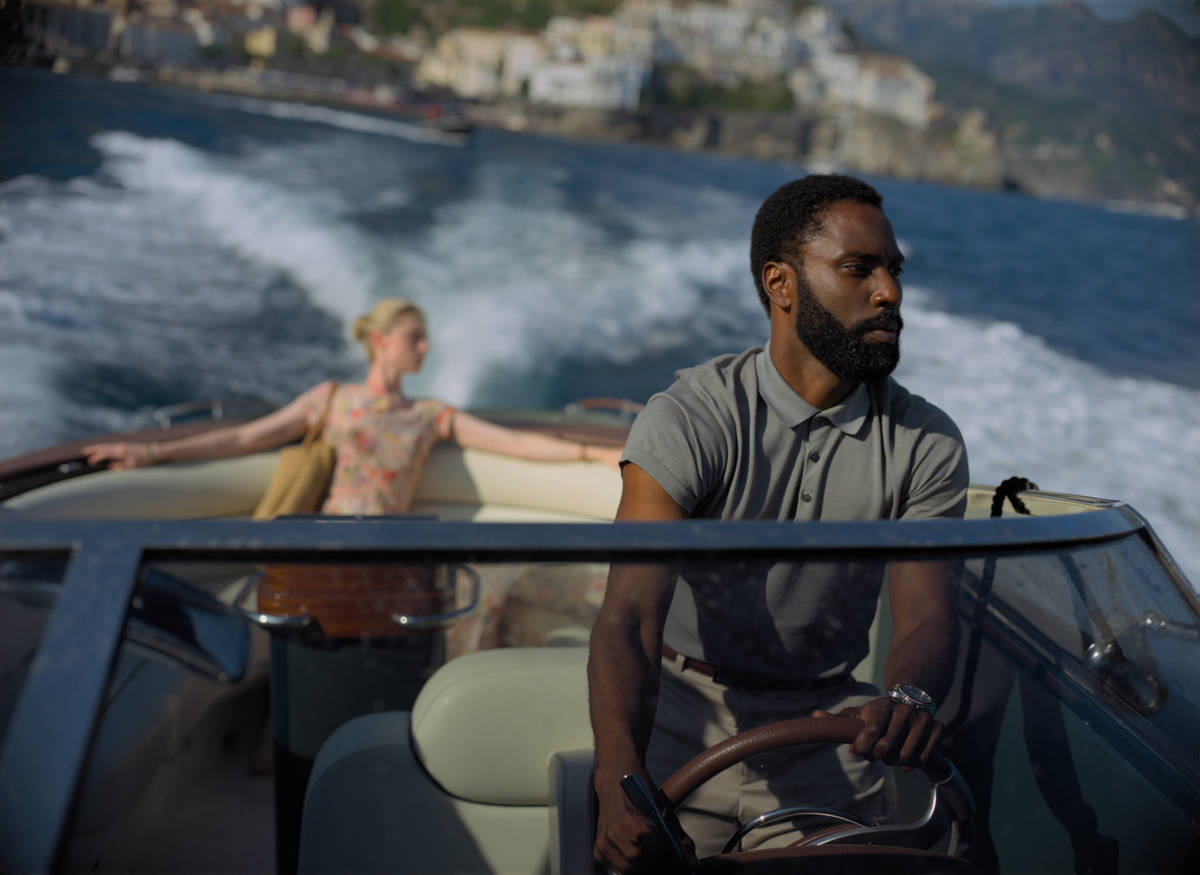 "ELIZABETH DEBICKI and JOHN DAVID WASHINGTON star in ""TENET."" (Warner Bros. Entertainment)"