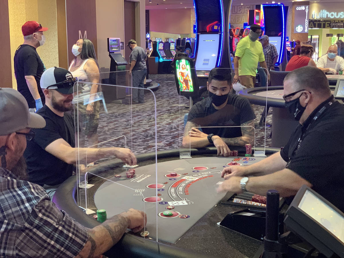 Individuals play table games at Gila River Casino's Lone Butte location on the packed reopening … | Las Vegas Review-Journal