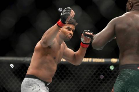 Alistair Overeem, left, in action against Jairzinho Rozenstruik during their heavyweight mixed ...