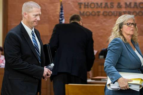 Henderson police officer Jared Spangler, left, and attorney Lisa Anderson leave the Thomas & Ma ...
