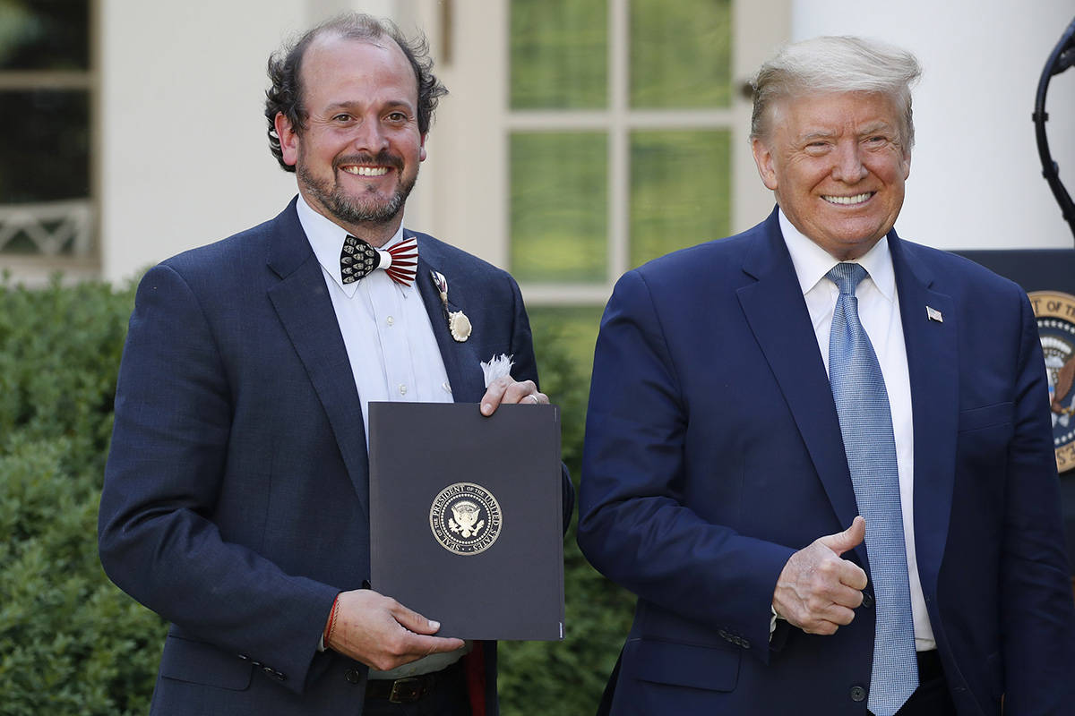 President Donald Trump poses for a photo with Ben Ross during a presidential recognition ceremo ...