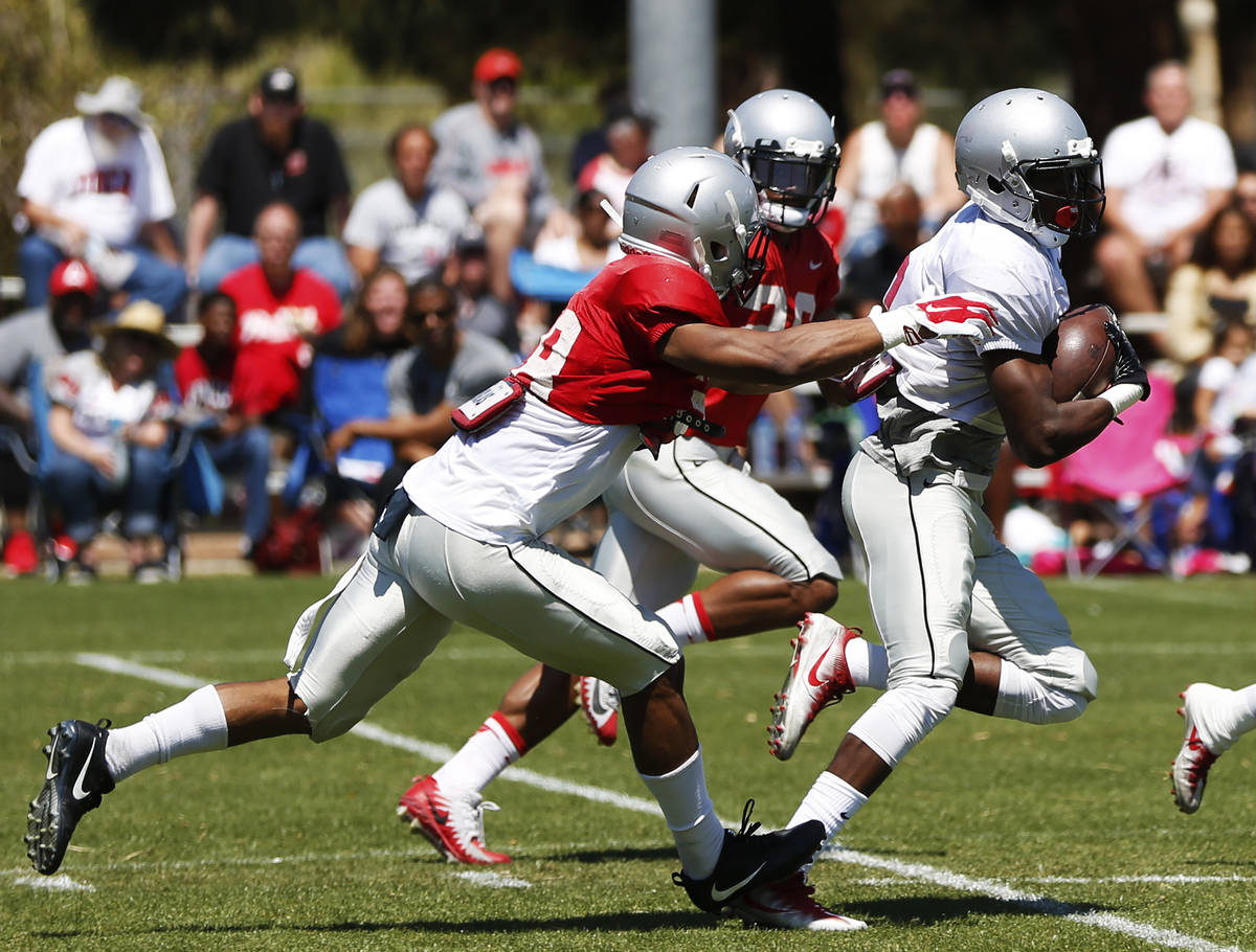 UNLV's wide receiver Mekhi Stevenson (2) runs the ball as defensive backs Ty'Jason Roberts (38) ...