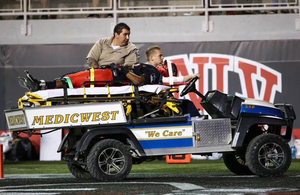UNLV Rebels defensive back Ty'Jason Roberts (38) is taken off the field by medical staff after ...