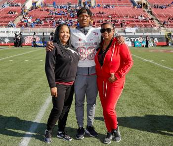 UNLV's Ty'Jason Roberts stands on the field with his aunt Kishawanda Bellos, left, and his moth ...